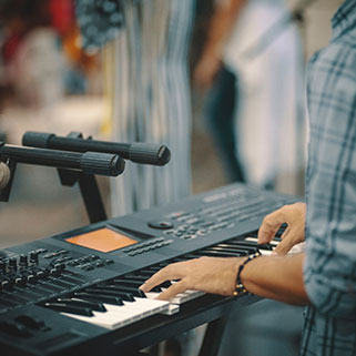 man playing keyboard